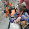 Hard Life: Mothers and children wait for help in desperate conditions